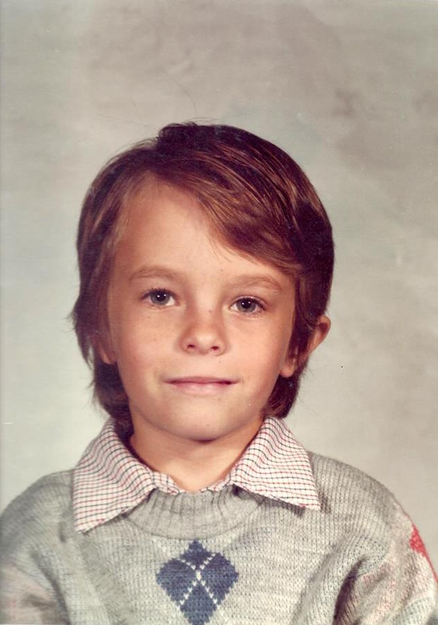 Photograph of Daniel as a child in first grade