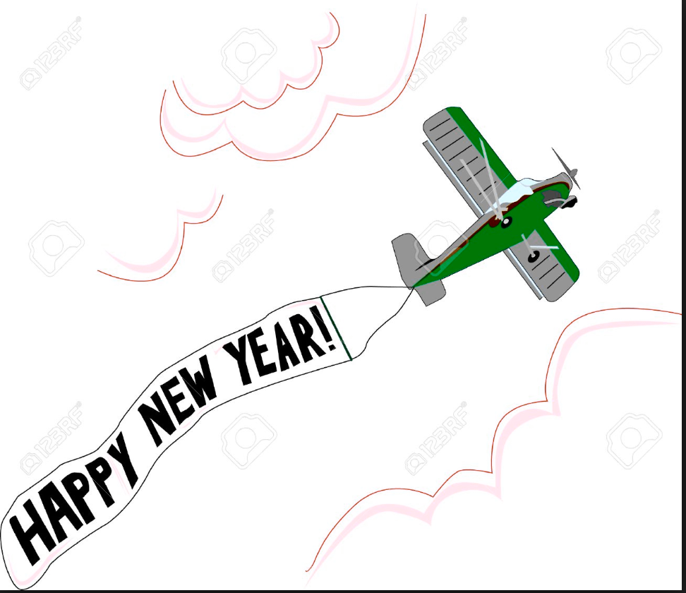 Happy New Year written on a sign behind a plane