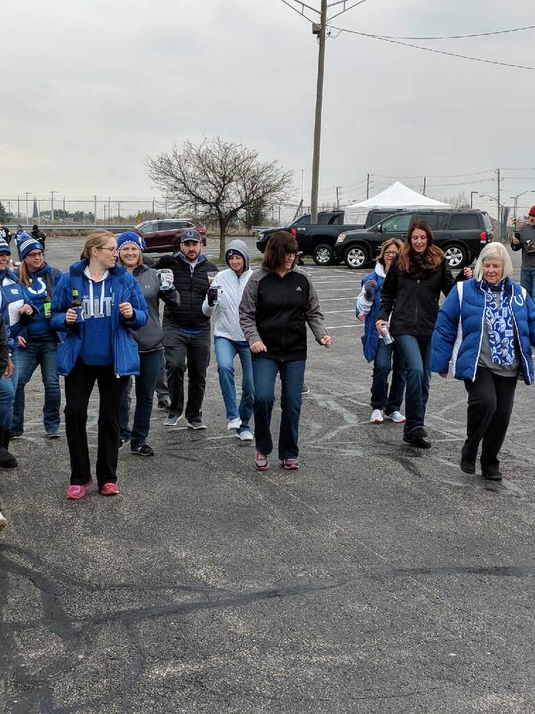 Sandy dancing with Colts fans.