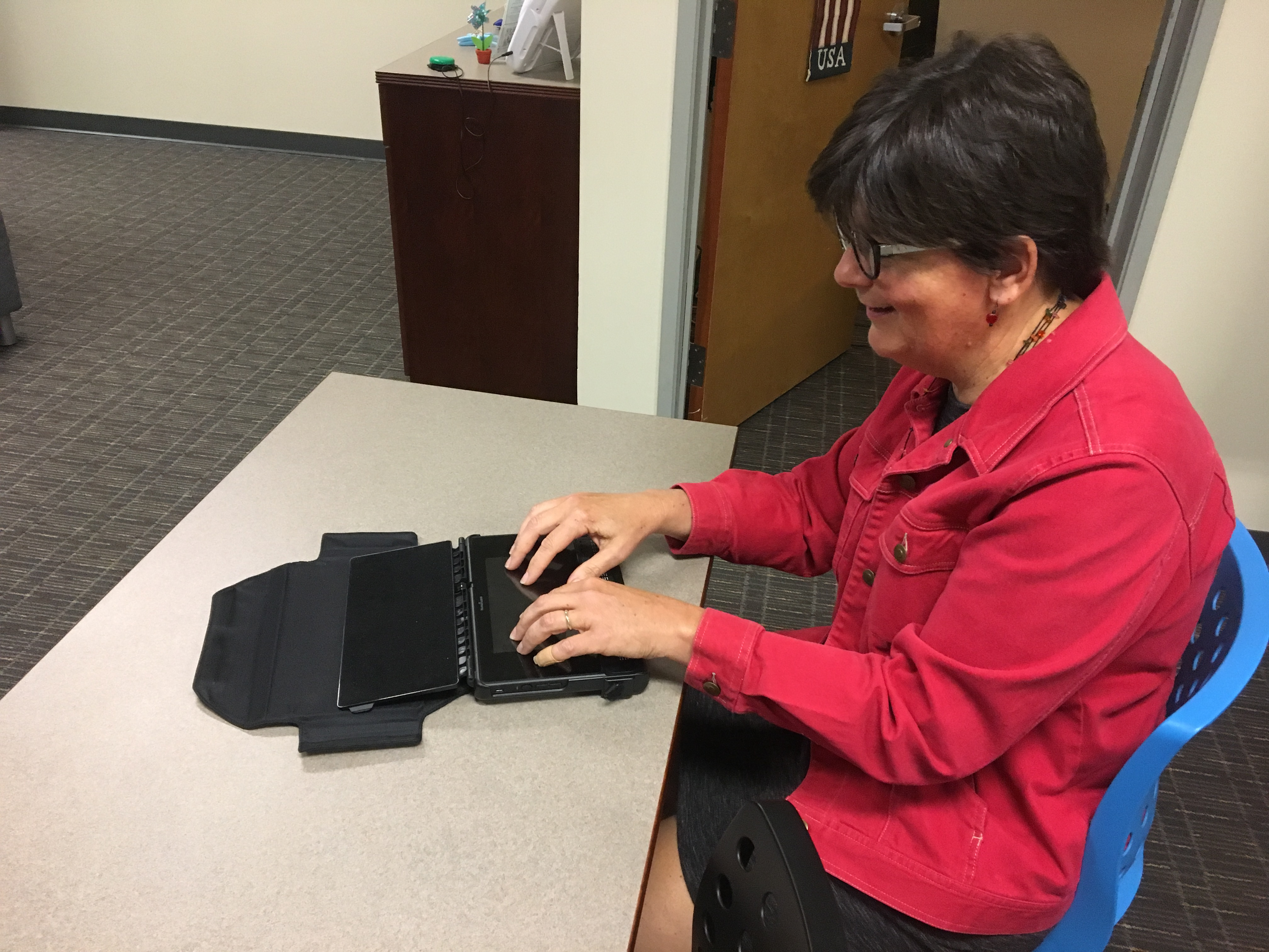 Bev Sharritt using a Braille Note Touch