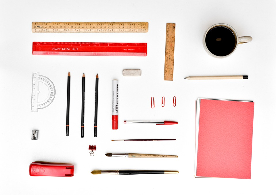 Neatly organized office supplies and a cup of coffee