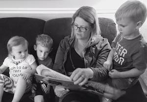 Mimi reading to three of her Grandkids.