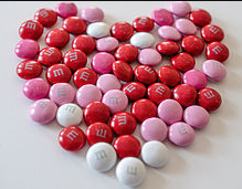 Pink & read M&M candies in heart shape.