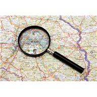 magnifying glass laying on map