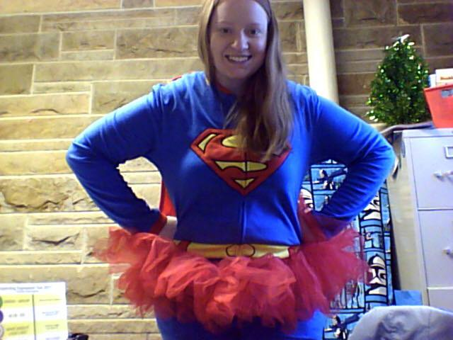 Jessica dressed and posing as superman with a red tutu
