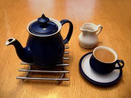 teapot with cup and milk
