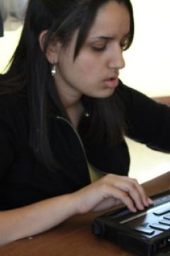 Student using a Braille Notetaker