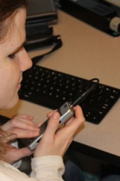 Student using a Digital Player/Recorder